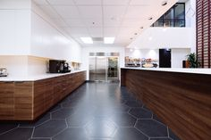 Pearl Headquarters. Scotts Valley, CA Commercial Office Kitchen. Large Format Hexagon Tile.
