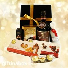 THE CHOCOHOLIC WITH LIQUEUR For the serious chocoholic, this sensational selection of chocolates and chocolate liqueur will satisfy more than the sweet tooth.   Bottle of Nachtmusik chocolate liqueur Ferrero Rocher chocolate trio Toblerone bar Lindt Lindor assorted chocolate box Handmade cranberry chocolate salami Box of Cointreau caramel Belgian chocolate truffles Box of cherry liqueur Belgian chocolate truffles Belgian Chocolate, Chocolate Box, Chocolate Truffles, Hamper Boxes, Gift Hampers, Truffle Boxes, Ferrero Rocher Chocolates, Cherry Liqueur, Lindt Lindor