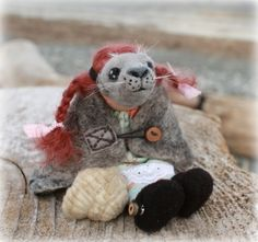 Coral, the Selkie Child. Removable costume on a charming, needle felted girl doll with a seal friend.