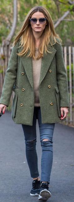 Who made Olivia Palermo's cat sunglasses, green coat, and black sneakers?…