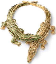 Crocodiles necklace, made to order by Cartier Paris for Maria Felix in 1975. Made of gold, with 1,023 brilliant-cut yellow diamonds with an overall weight of 60.02 carats, two navette-cut emerald cabochons, 1,060 emeralds of a total of 66.86 carats, two ruby cabochons. Via Diamonds in the Library.