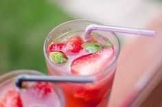 Strawberry Basil Lemonade (this makes 2 glasses)  Pink or Yellow Lemonade (i used Newman's Own)  2 large fresh strawberries, sliced  handful of frozen strawberry slices (i slice them, pop them in a ziploc bag & freeze them to use all summer)  5 basil leaves, per glass
