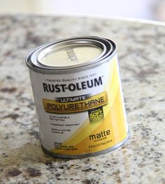 Coat top with Rust-Oleum Polyurethane.  This stuff is great!  You can't even see where you have applied it, and  it protects the wood from water and kids