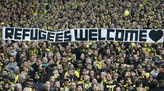 """Refugees Welcome"" banners are displayed at football matches in Germany. Is this unique?"
