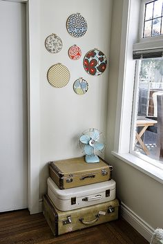 Craft Room Storage and Wall Decoration. perfect Fabric rings, vintage tuquoise fan and suitcases!