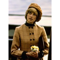 A newly married Diana dons a conservative coatdress designed by Arabella Pollen on a royal visit in Wales.    - MarieClaire.com