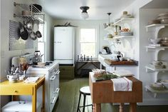 I love the vintage kitchen appliances and the butcher block work table and all of the open shelving.