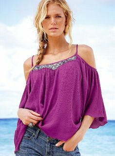 This sequin accented gauze top (Victoria's Secret) will show off your shoulders  but keep the piece behind your hip a secret.