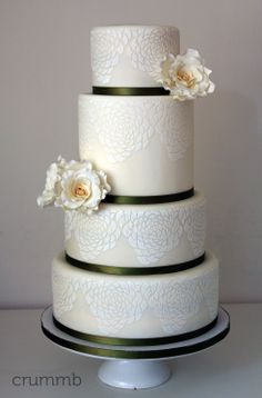 Ivory wedding cake with olive green ribbons, gumpaste roses and floral icing pattern using Designer Stencils. By Crummb, Singapore.