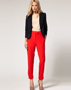 Statement red pants, neutral top, and black blazer - trendy work attire for any office (except finance - I don't think they allow red pants)