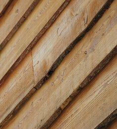 Waney-edge green oak cladding from Vastern Timber