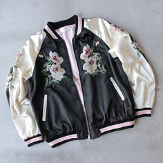 - Reversible jacket - floral embroidery on front, sleeves, and back - front pockets & zip closure - imported
