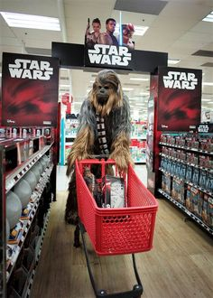 Image: A fan dressed as Chewbacca shops for merchandise from the upcoming film 'Star Wars: The Force Awakens