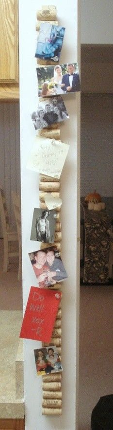 Mom! Hot glue corks on a yard stick and you get a vertical cork board - great for small spaces / wall ends