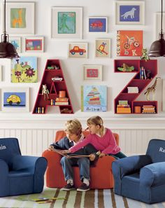 Displaying Artwork in a Play Space   Pottery Barn Kids - LOVE the artwork in white frames and the white bead board!