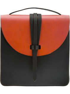 Red and black leather boxy shoulder bag from M.Hulot featuring a small top handle, a front flap closure with strap closure design, a thin shoulder strap with gold tone fixtures and a large inner compartment with a zip fastening pocket and a signature logo tag. Item ID:10318110