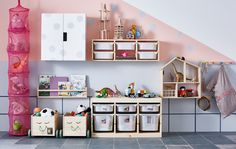 Convenient toy storage is set up on the wall of a kid's room.