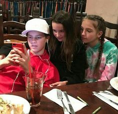 Hayden,Annie, & Jayden eating at a restaurant