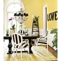 Love this dining room. The warm yellow radiates happiness and the Louis Chairs from Ballard Designs offer a striking contrast.