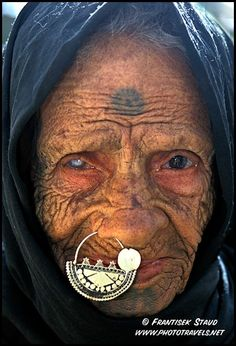 Close up portrait of 90-year-old Arabic woman, Bahariya Oasis, Libyan Desert, Egypt - by Frantisek Staud