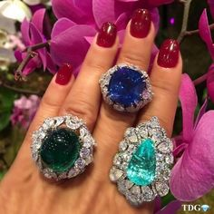 Sapphire, Emerald and Paraiba Tourmalline rings. All precious are set in the center surrounded by diamonds!!!