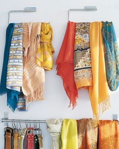 A pair of paper-towel holders mounted on the inside of a closet door organizes scarves or ties and keeps them wrinkle-free.