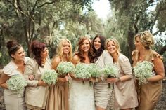 Multiple plusses here: 1)the bride's hair/makeup is GORGEOUS. 2)the simple and sweet baby's breath by itself actually makes gorgeous and cheap sweet little bouquets! Love!