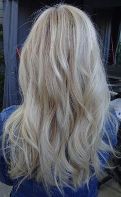 A bright baby blonde....  Colorist Sarah Conner gives her client all-over super-fine highlights for a refreshing new look.
