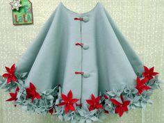 Felt tree skirt, but would also be an interesting wearable skirt/cape...