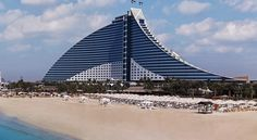 Jumeirah Beach Hotel Dubai This 5-star luxury Dubai hotel has a private beach and features over 16 dining options, 6 pools and a climbing wall. Guests staying at any Jumeirah Beach Hotel room can enjoy free unlimited access to Wild Wadi Waterpark.