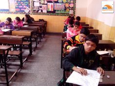 students listening instructions for NLC exam conducted by AVAS India in 2013