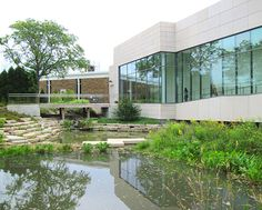 Johnson Controls Headquarters (Glendale, Wisconsin): With a stream & wetlands bisecting the property, water conservation & re-use are especially significant. Rain water runoff from roofs & permeable pavement is collected & reused for toilet & urinal flushing or diverted into rain gardens & a decorative pond. 13 acres of lawn were replaced with a diverse native prairie plants & walking trails. These sustainable site strategies resulted in a net reduction in impervious cover for the campus.