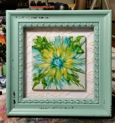 Neat art idea to do with your painted tiles, frame them in an old frame you can paint and then you can paint a background, use fabric, lace or even wallpaper to accent your tile. Flower ceramic tile art in alcohol ink with frame by Tina.. Please also visi