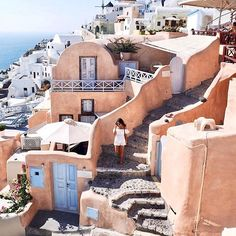 Running through the town of Oia, Santorini ✨