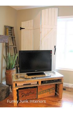 """Pallet TV stand. Nice how the electronic accessories fit """"in"""" the pallet."""