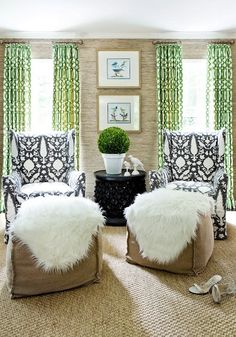 Lovely for a casual sunroom/reading room - Kelly Wearstler's Imperial Trellis curtains in green, sheepskins draped over the ottomans; clipped boxwood, sisal rug, textured walls