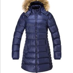 Beautiful navy blue puffer coat Beautiful navy blue puffer coat with faux fur trimmed hood. This coat is cute sleek and warm. Has zipper pockets on each side. The hood is removable. Brand new never worn. Elora Jackets & Coats Puffers