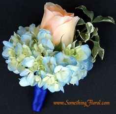 Peach and blue groom's boutonniere featuring a soft peach rosebud and light blue hydrangea, finished with royal blue satin on the stemwrap. Designed by Something Spectacular / Something Floral in Warren, Michigan. #wedding #boutonniere # buttonhole #groom #groomsmen