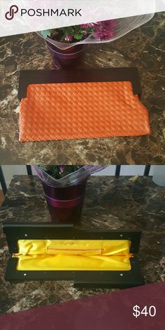 Stylish cluch purse Cluck purse tangerine orange with black hard handles. Pops open and close for a secure hold. Great bag not to small or to big it will go great with a spring dress. Feel free to, Make me a offer! Bags Clutches & Wristlets