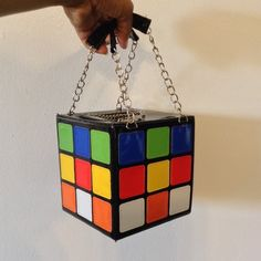 """✨✨ CUBE PURSE ✨✨ 5 1/2"""" cubed measurement; 5"""" drop on chain handles; handle covered with patent leather; zip top closure with chain handle; beige cloth interior; four inside pockets; hard plastic covered in patent leather; black top/bottom; four sides (multicolor); new; never used Bags Mini Bags"""