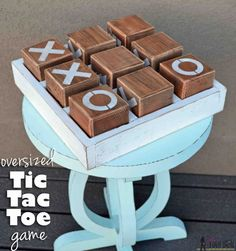 Easily build! A fun wooden tic-tac-toe game to sit on the ottoman or side table. Free woodworking plans!