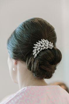 Wedding hair idea: chignon bun with elegant clip.