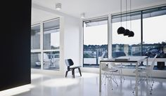 A penthouse in Copenhagen full of Vitra chairs: Panton Chair on the balcony and Eames' LCW and DSR inside.
