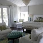 bedrooms - capiz chandelier tufted white headboard turquoise blue gourd lamps white chairs oval blue tufted ottoman Oly Studio Serena Chandelier