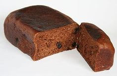 Malt loaf is a common snack food in the United Kingdom. Malt loaf has a sweet taste and a very chewy texture like very heavy, soft bread. It is made from malt and often contains fruit such as raisins. Malt loaf is usually eaten sliced and with butter. Malt Loaf, Sticky Pudding, British Desserts, Bread Maker Recipes, Irish Soda Bread Recipe, Grain Foods, English Food, Snack Recipes, Cake Recipes