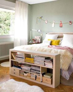 Love the shelf at the foot of the bed.