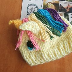 This colorful hand knit unicorn hat will bring a bit of whimsy everywhere it goes. Hand knit in a beautifully soft acrylic yarn, it is machine washable and dryable! Available in sizes from infant to adult at www.knitabitofwhimsy.com