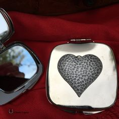 Our purse mirror is embellished with a silver hammered heart.   This purse mirror features two mirrors and is individually boxed in a small black gift box.   A great gift for Valentine's Day, for bridesmaids, or any special occasion. Gifts For Wine Lovers, Wine Gifts, Valentine Day Gifts, Valentines, Wine Purse, Wine Tourism, Great Wedding Gifts, Wine Bottle Stoppers, Black Gift Boxes