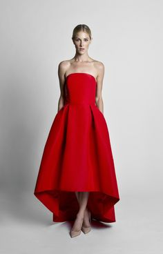 Silk faille Straight strapless neckline Fitted bodice with boning for support Seam at natural waist Pleated full skirt with high-low hem Side slit pockets Concealed back zipper …
