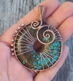wire wrapped stone....i am inspired to  try something similar to this with one of the stones i have handy.